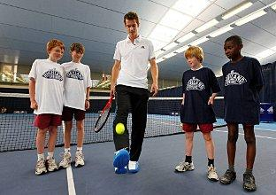 Skillful: Andy Murray teaches Tennis Football to youngsters from St Mary's Church of England Primary School, in Putney