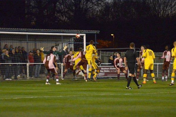 Before the darkness: Romone McCrae scores in Tuesday's Surrey Senior Cup tie at Cornithian Casuals, which ended in darkness when the floodlights failed with 17 minutes remaining