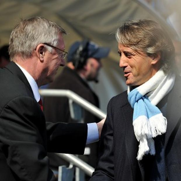 Sir Alex Ferguson (left) and Roberto Mancini