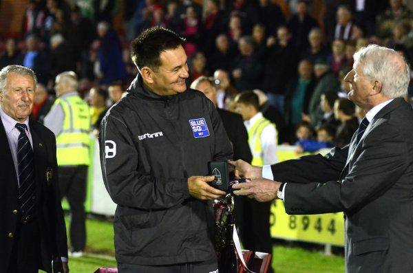 Proud: Sutton boss Paul Doswell collects his Surrey Senior Cup runners-up medal at Kingsmeadow on Tuesday