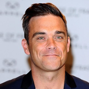 Robbie Williams is to captain the England team in the Soccar Aid match at Old Trafford