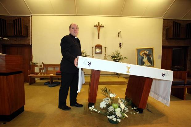 Father Peter Jenna with the temporary altar