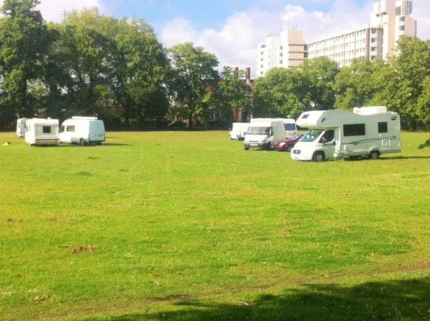 Travellers who pitched their caravans on a recreation ground in Kingston say they want to stay for a week.