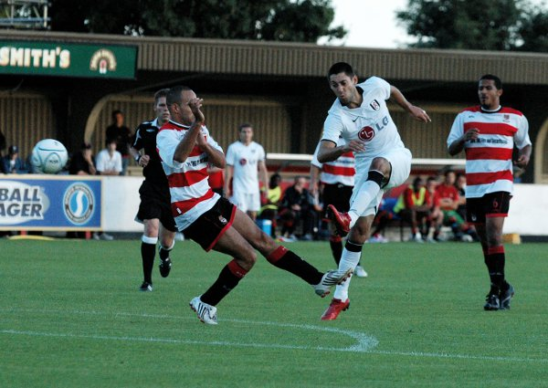 Star show: Fulham's Clint Dempsey lets fly and Jon Coke takes evasive action during the Cottagers' 8-0 friendly triumph over Kingstonian at Kingsmeadow in 2008 	Deadlinepix SP22293