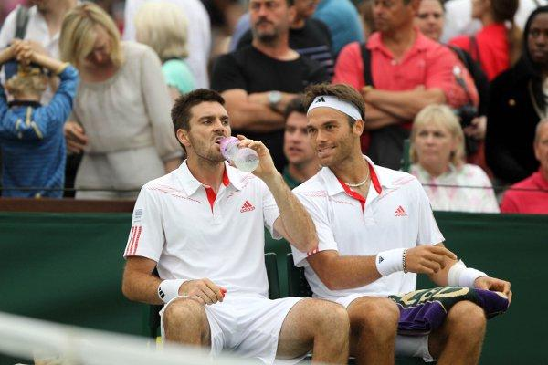 Home sweet home: Wimbledon's Ross Hutchins, right, with doubles partner Colin Fleming at SW19 last week