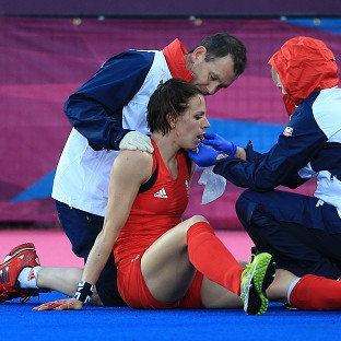Kate Walsh, centre, was injured in the game against Japan