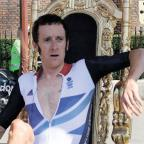 Kingston Guardian: WHAT A HERO: Bradley Wiggins on his throne at Hampton Court Palace after winning his gold medal