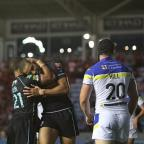 On the verge: London Broncos' Kieran Dixon, left, and Omari Caro celebrate a score      SP69678