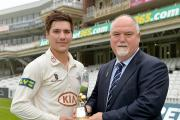 Come a long way: Banstead CC's Rory Burns collects the breakthrough player of the year award from Mike Gatting after a season opening the Surrey CCC batting