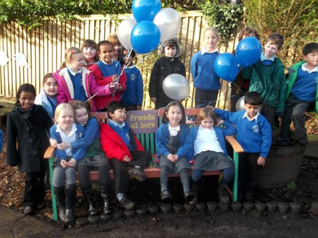 Coombe Hill Infants' School children on their friendship bench