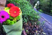A floral tribute left in Old Malden Lane after the fatal traffic accident in November