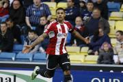 Goal rush: Brentford's Andre Gray celebrates the first of his two goals at Millwall on Saturday   Pictures: Niall O'Mara