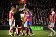 Carded: Marouane Chamakh was booked in the 1-1 draw against Stoke City before limping off with a hamstring injury                   SP89019